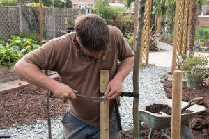 Chris adding tree protection to garden
